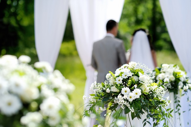 White flowers decorations during outdoor wedding ceremony