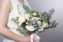 Gentle wedding bouquet in hands of the bride.