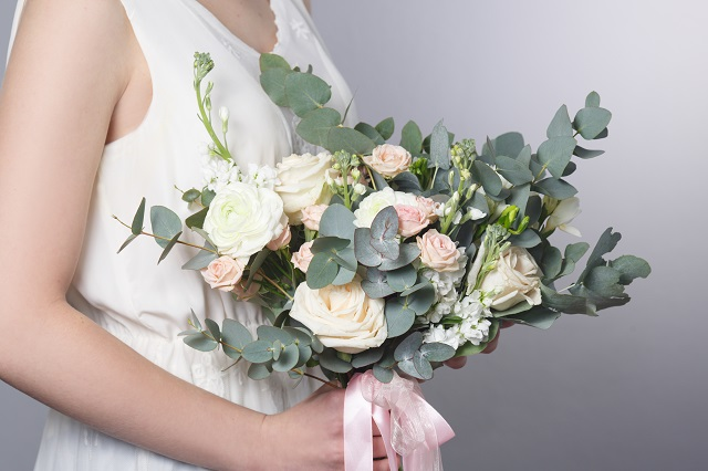 Gentle wedding bouquet in hands of the bride.