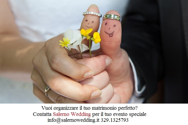 Wedding rings on their fingers painted with the bride and groom, funny little people