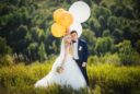 Wedding. Wedding day. Happy, smiling newlyweds with helium balloons having fun after wedding ceremony. Wedding concept. Marriage