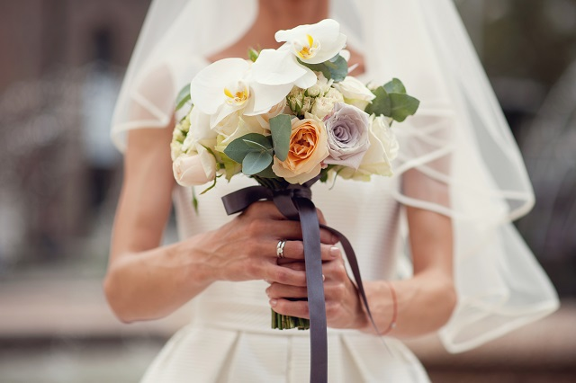 Bride hands with wedding bouquet