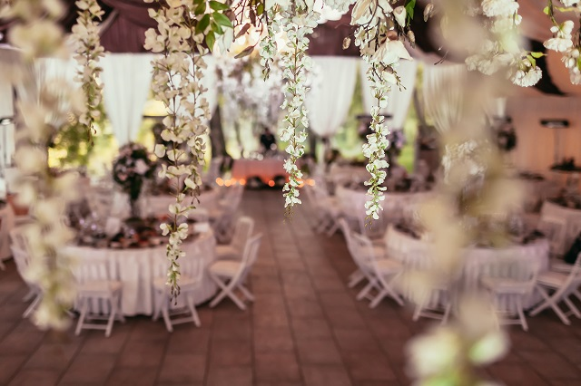 flowers decoration on wedding banquet with tables and catering